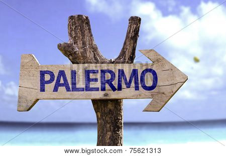 Palermo wooden sign with a beach on background