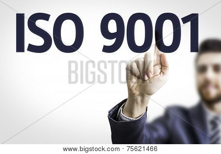 Business man pointing to transparent board with text: Iso 9001