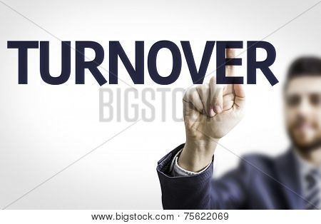 Business man pointing to transparent board with text: Turnover