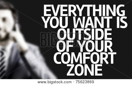 Business man with the text Everything You Want is Outside of Your Comfort Zone in a concept image