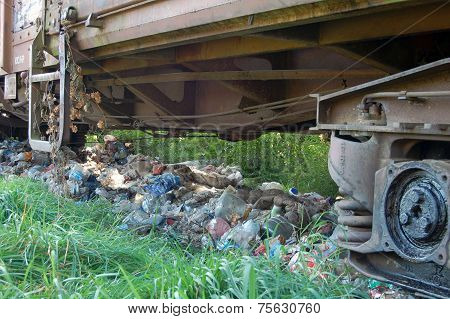 Garbage Underneath Railway Cars
