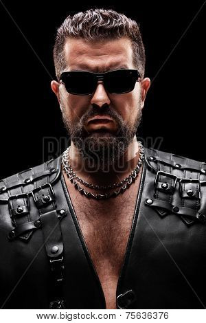 Male biker with sunglasses on black background
