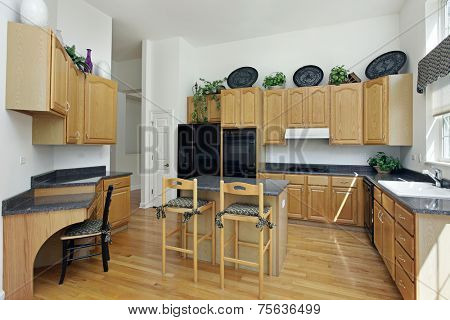 Kitchen with island and oak wood cabinetry