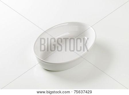 white oval bowl on white background
