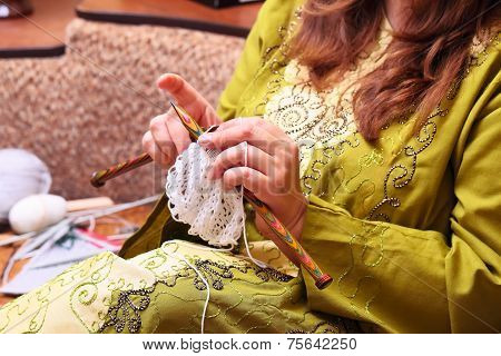 woman hands knitting