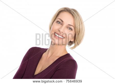 Lucky isolated blond mature woman with white teeth and pullover in bordeaux color.