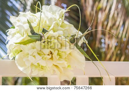 traditional philippino palm tree birds with wedding rings on wedding bouquet background