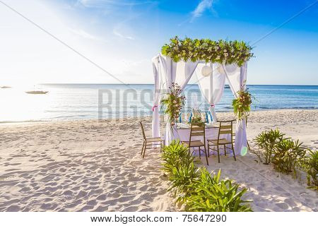 wedding arch and set up on beach, tropical outdoor wedding cabana on beach, wedding table for dinner
