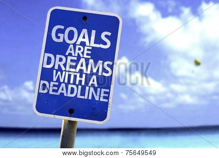 Goals Are Dreams With a Deadline sign with a beach on background