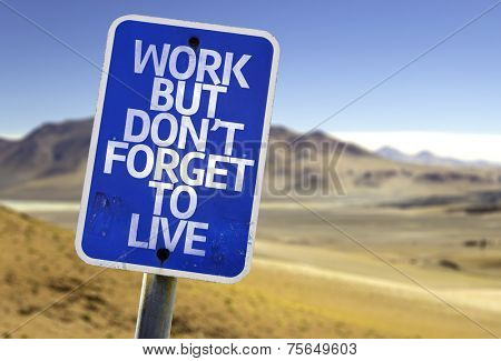 Work But Don't Forget to Live sign with a desert background