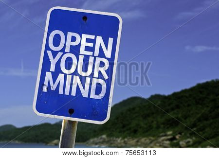 Open Your Mind sign with a beach on background