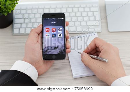 Businessman Holding Iphone 6 Space Gray With News Applications