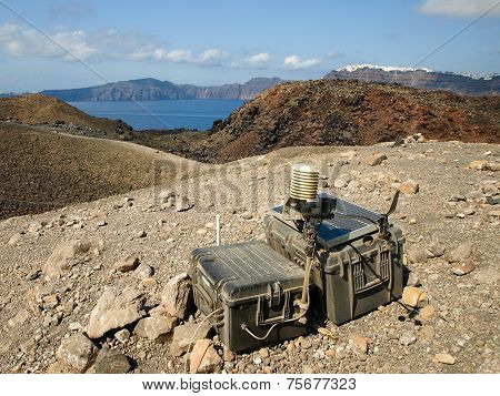 Device to measure volcanic activity with Fira in background Santorini Greece.