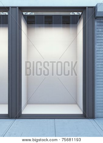 Empty storefront of shop with white wall