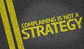 Complaining is not a Strategy written on the road poster