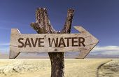 Save Water wooden sign isolated on arid background poster