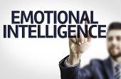 Business man pointing to transparent board with text: Emotional Intelligence poster