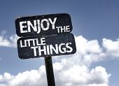 Enjoy The Little Things sign with clouds and sky background poster