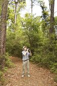Man with Binoculars Birdwatching on a Forest Trail - Texas poster