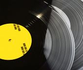 Black vinyl records stacked up closeup photo poster