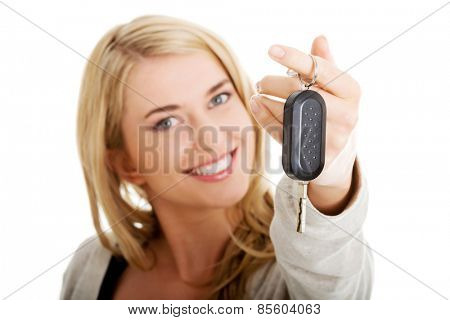 Portrait of happy woman holding a car key.