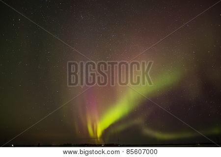 Aurora borealis bursting from the ground