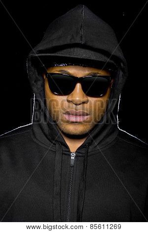 young black male wearing shades and hood is a criminal or misunderstood urban youth poster