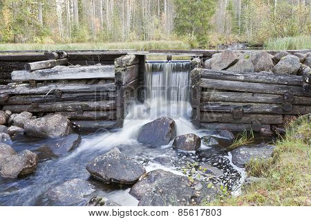 A water power construction made of wooden logs.