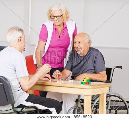 Happy senior people playing Bingo together in a nursing home