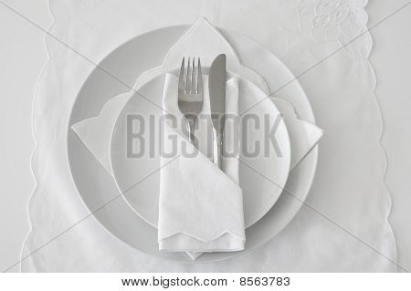 Table Place Setting with white linen and plates