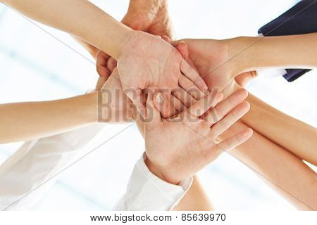 Many hands stacked as concept for motivation and teamwork