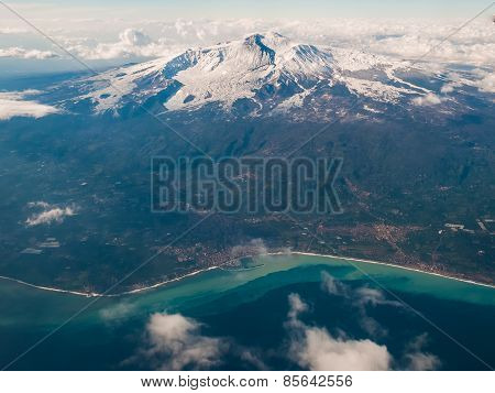 Volcano Etna and surrounding towns as seen from an airplane during the winter poster