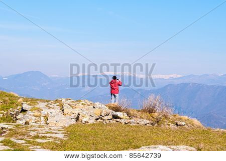 An Hiker Takes A Picture From The Summit Of A Mountain