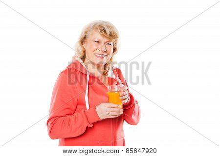 Mature smiling woman with orange juice