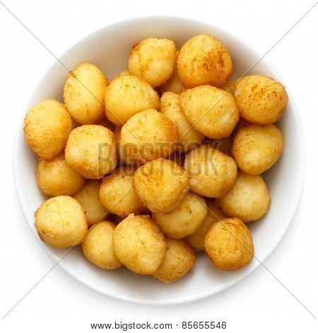 Golden fried small potato balls.