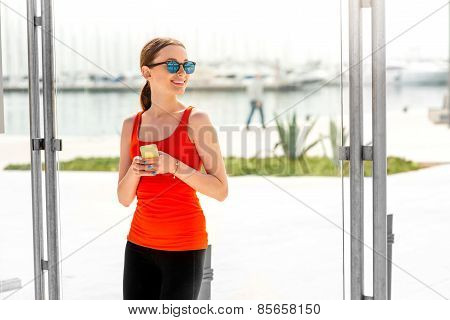 Sport woman at the bus station