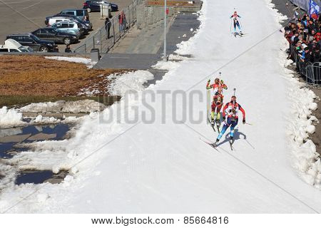 MOSCOW - APR 05, 2014: Three biathlete running distance on the Race of champions biathlon in Sports Complex