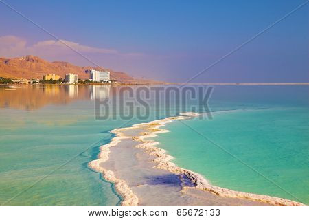 Israel in October. The patterns evaporated salt in the Dead Sea. Salt formed a long track with scalloped edges.
