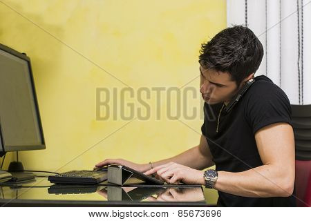 Young Businessman Or Home Worker Taking A Call