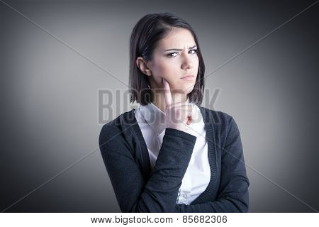 Thinking woman standing pensive contemplating looking skeptic.Thinking business woman