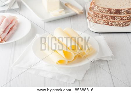 Cheese Rolled Up On White Plate