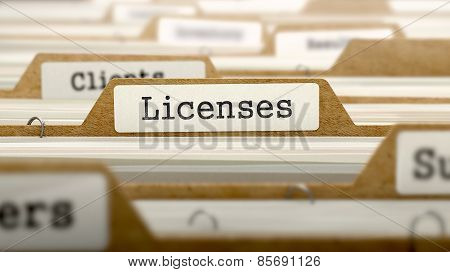 Licenses Concept with Word on Folder.