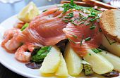 Fresh Salmon with lemon and bread . poster