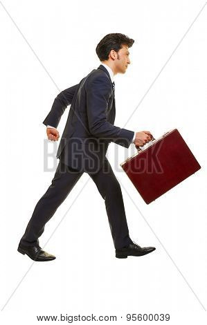 Business man walking in profile with a briefcase