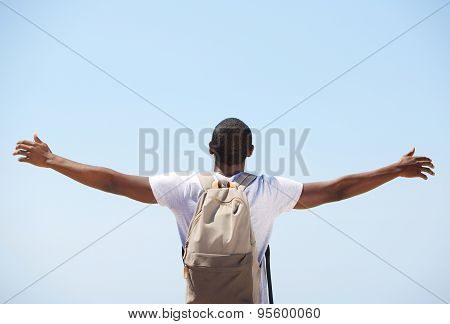 Young Black Man Standing With Arms Outstretched
