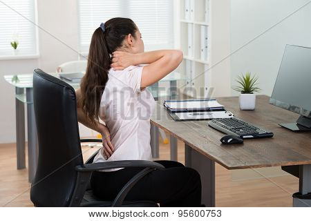 Businesswoman Having Backpain In Office