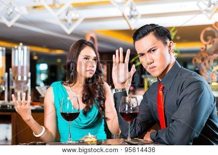 Couple quarelling in restaurant