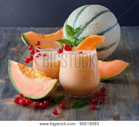 Healthy Smoothie Drink With Red Currant Berries And Cantaloupe Melon For Breakfast