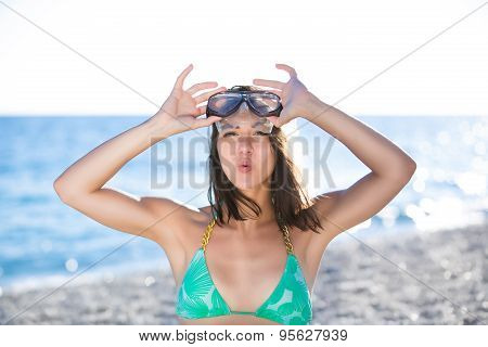 Woman on beach vacation having fun with snorkeling mask,enjoying the sun on summer day.Woman in a tr