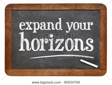 Expand your horizons - motivational text on a vintage slate blackboard poster